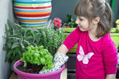 Young girl gardening plant smiling
