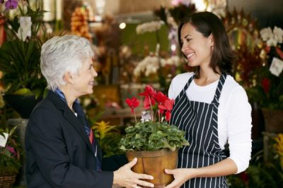 Florist Helping Senior Female Customer to Choose Plant