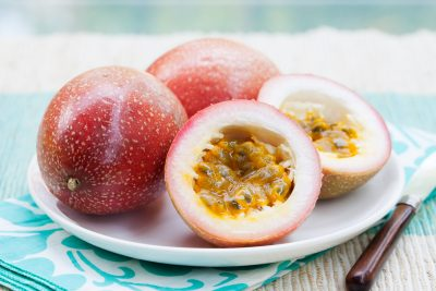 Passion fruits on blue napkin Outdoor background